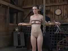 Caged angel gets a whipping..